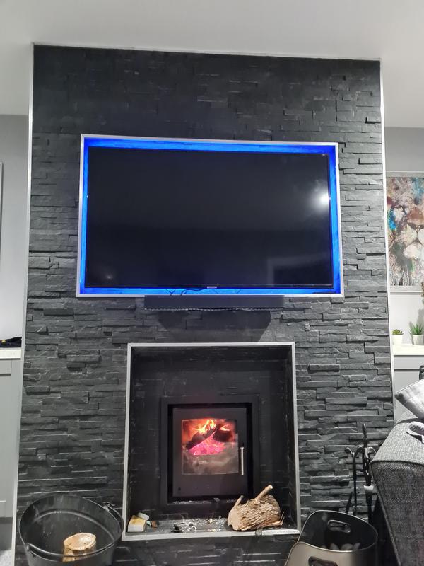 Image 9 - TV/media wall built round a log burner and tiled