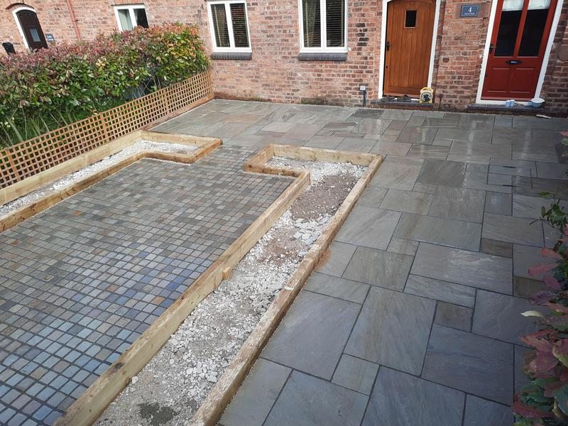 Image 8 - A Landscaping Job in Churton, Cheshire that we completed. Full excavation and 40m2 Promenade Indian Stone laid with 20m2 matching cobbles. Sleeper beds created ready to plant