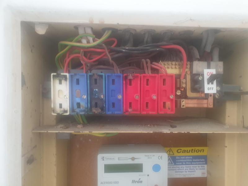 Image 32 - Old fuseboard with thermal damage on fuses from overloaded circuits and burnt out cables