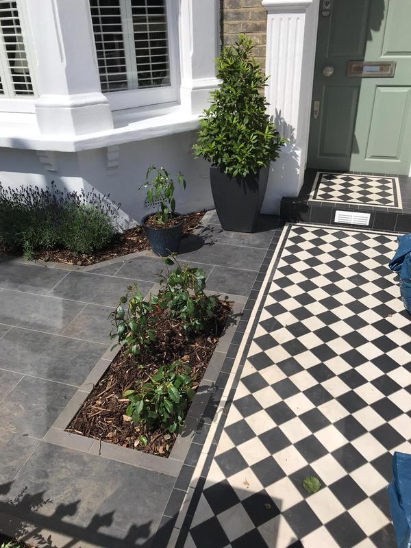 Image 17 - Refurbishment of entire front garden. The process included removal of entire brick floor reinforced and replaced with Victorian style tiles. The entire front of the building was painted and a gorgeous storage boxwith a flower bed was built.