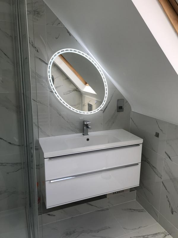 Image 8 - Complete refurbishment of loftbathroom, which included marble tiling of the entire bathroom, complimented with new sanitary ware as well as replacement of the power shower with an immersion pressurised heating system.
