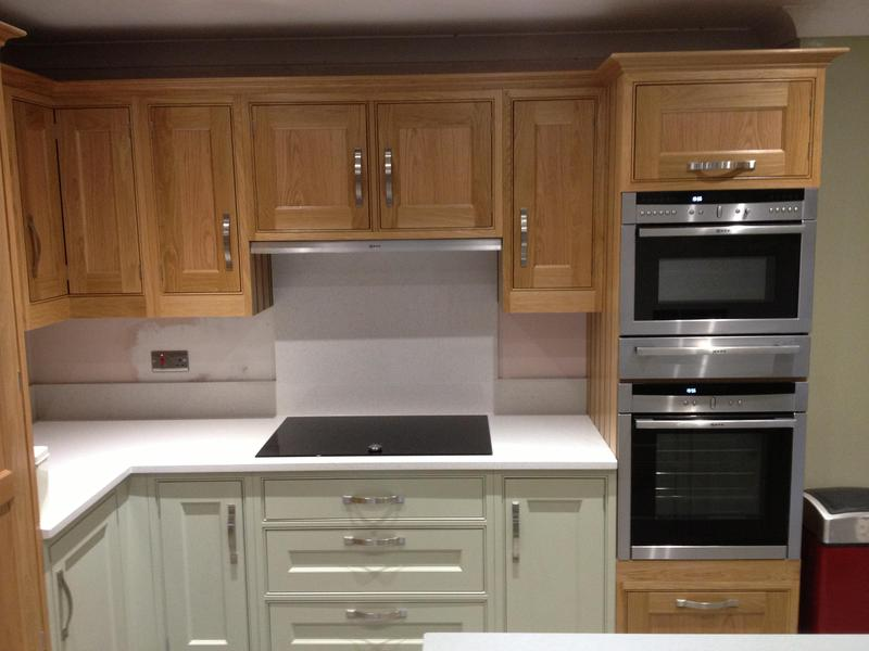 Image 112 - Cottage kitchen installed with bespoke panelling and shelves.
