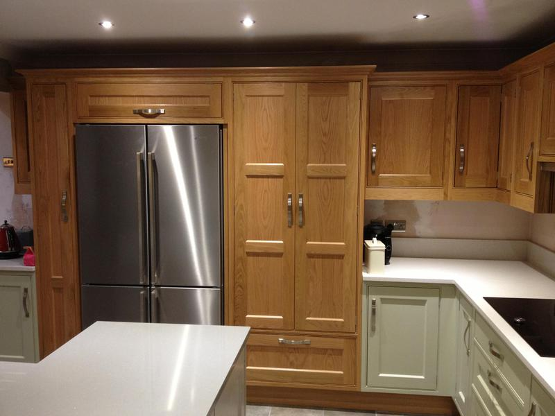 Image 113 - Cottage kitchen installed with bespoke panelling and shelves.
