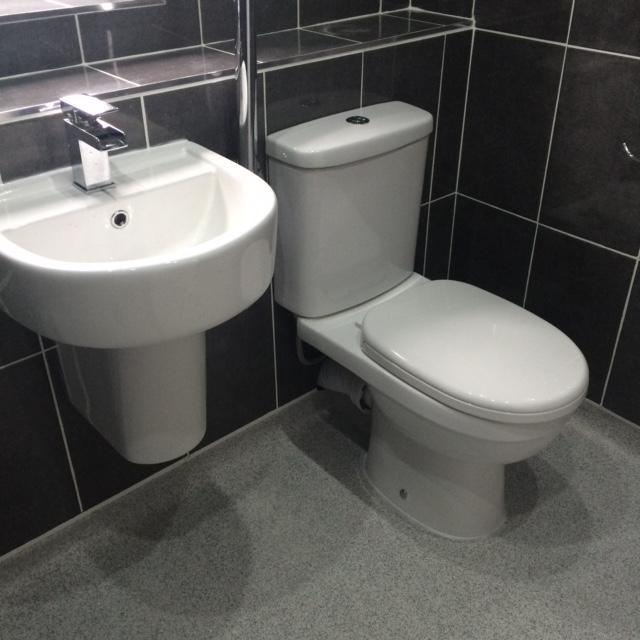 Image 9 - Wet floor shower room, full tiling, wash hand basin with semi ped, close couple toilet and pull down arm support.