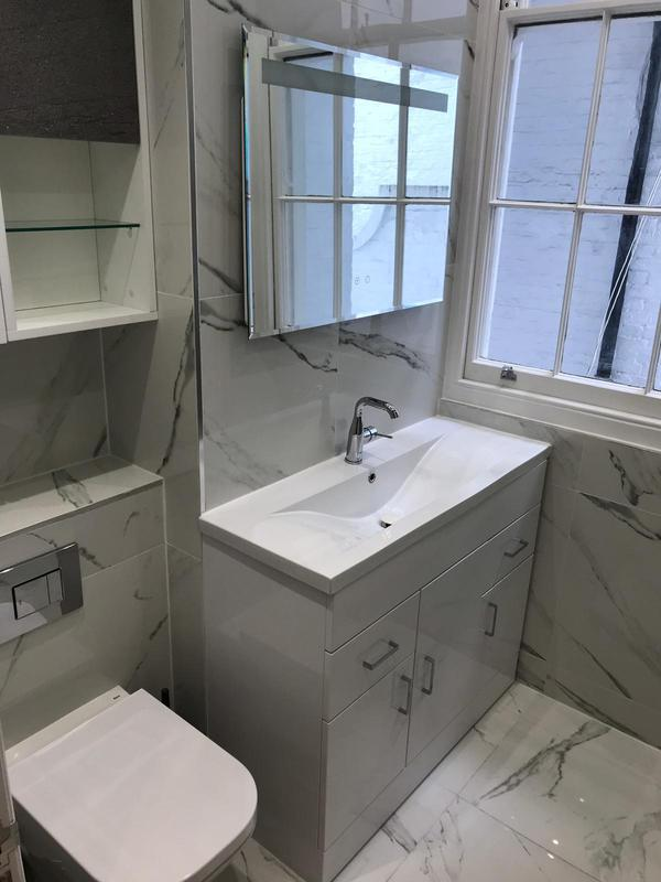 Image 22 - Complete renovation of an ensuite bathroom using marble tiling for the floor and walls. Complete with fixtures and fittings.
