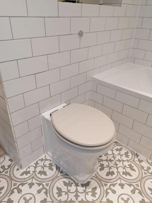 Image 1 - RELM completed a bathroom revamp in Putney. This bathroom was stripped down, given a fresh paint, new flooring, new tiling, plumbing and new fixtures and fittings installed.