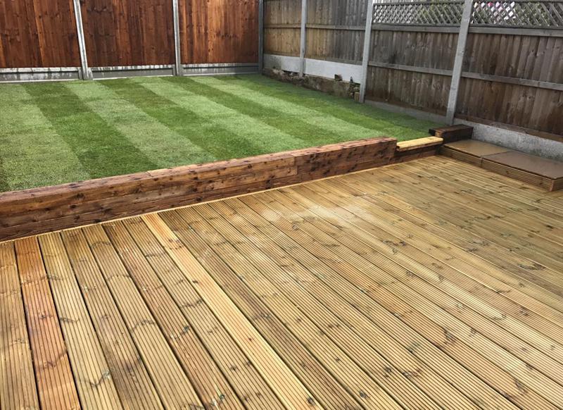 Image 14 - Full garden renovation. Decking, sleeper retaining wall. lush green grass turf and fencing.