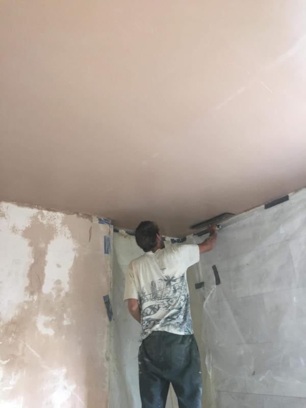 Image 22 - New bathroom ceiling being plastered