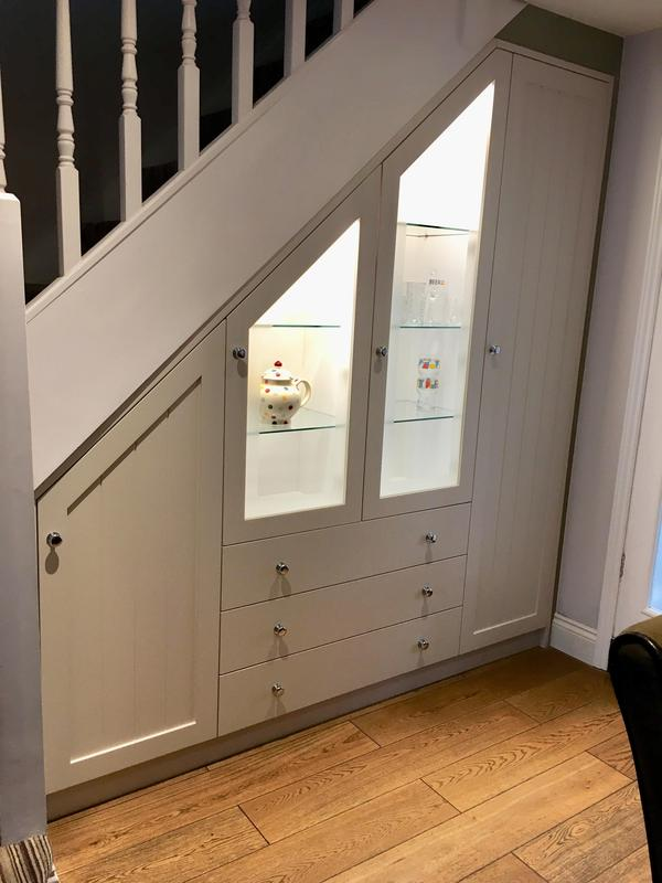 Image 18 - Bespoke built under stair storage and display. Sprayed polyester finish .