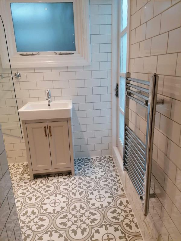 Image 2 - RELM completed a bathroom revamp in Putney. This bathroom was stripped down, given a fresh paint, new flooring, new tiling, plumbing and new fixtures and fittings installed.