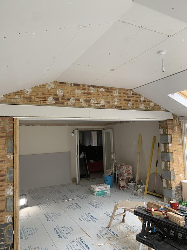 Image 26 - This was originally a lounge room with separate glass roofed conservatory.Its now a large open plan living space with a new tiled roof and plastered ceiling.