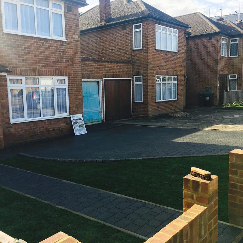 Image 39 - Marshalls Drivesett Argent in Graphite with Tegula Kerb in Pennant Grey and Brick wall with end columns
