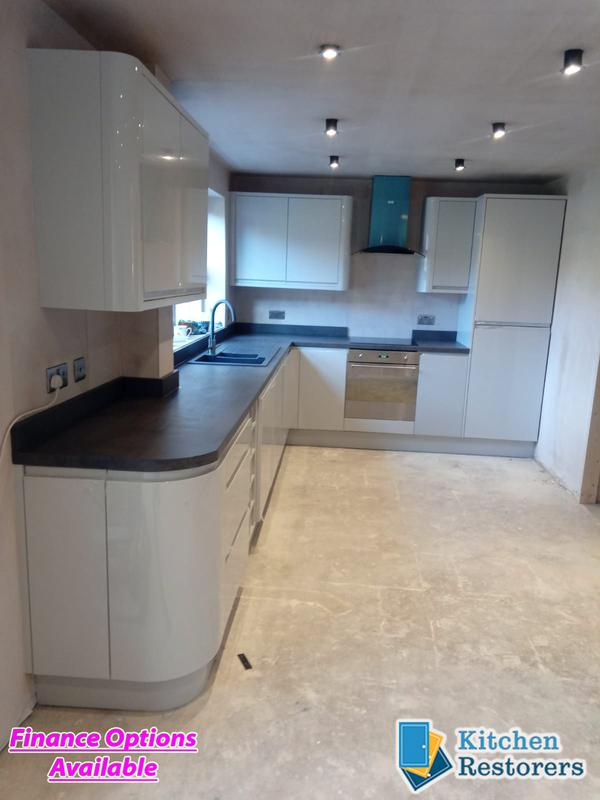Image 14 - Built in J Profile Handle Full Kitchen in a new ExtensionDoors: High Gloss Light Grey J ProfileWorktop: Laminate Bronze Chromix