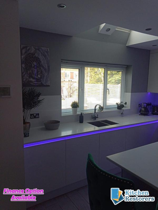 Image 3 - Full True Handle-less Kitchen FittedDoor Colour: Acrylic High Gloss WhiteWorktop: Solid Surface Peak