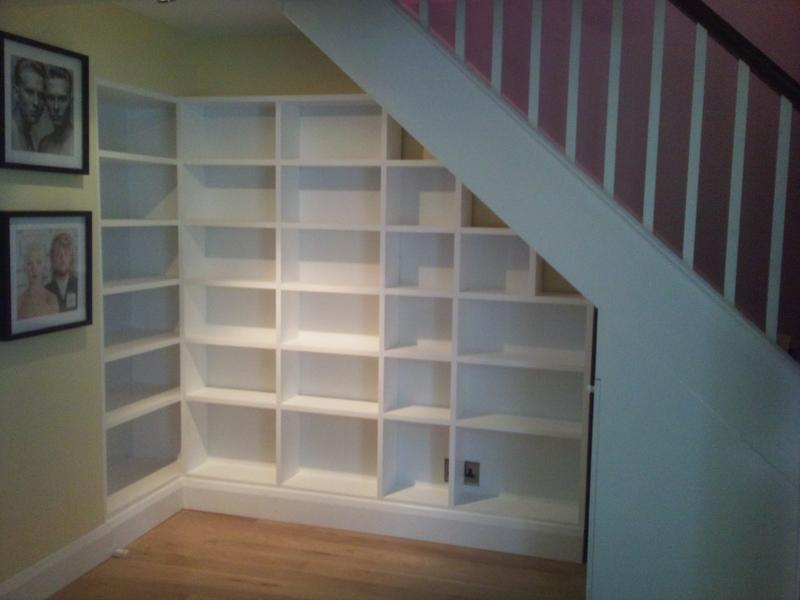 Image 12 - Shelving unit fits snugly under the stairs.