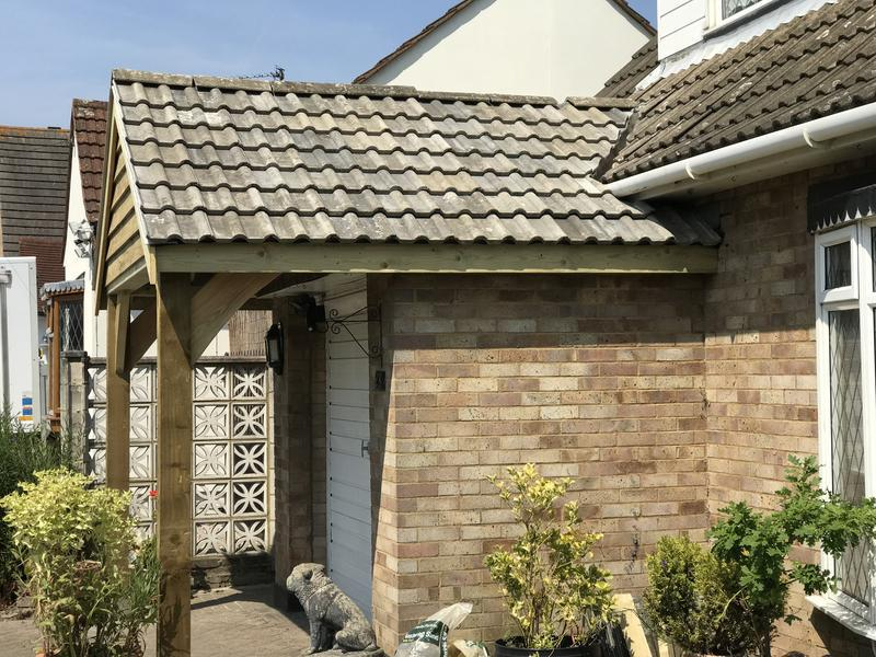 Image 58 - Simple tiled canopy over a flat roofed garage - sourced tiles to match worn original roof and look what a fantastic difference it makes to a house.