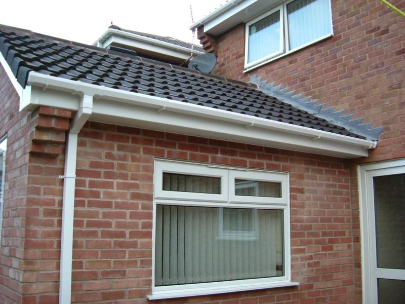 Image 163 - A large house completed with white square fascia,  tongue and groove soffit and guttering, down pipes, on all sides of her home,.