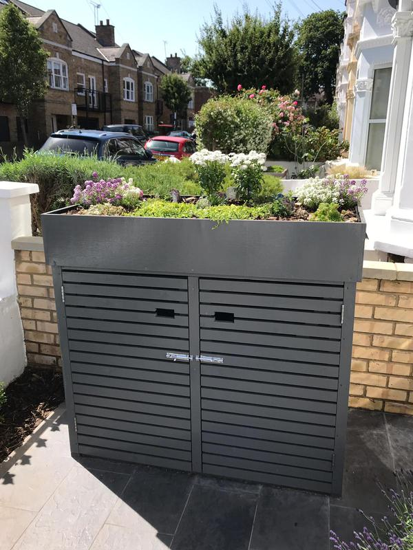 Image 18 - Refurbishment of entire front garden. The process included removal of entire brick floor reinforced and replaced with Victorian style tiles. The entire front of the building was painted and a gorgeous storage boxwith a flower bed was built.