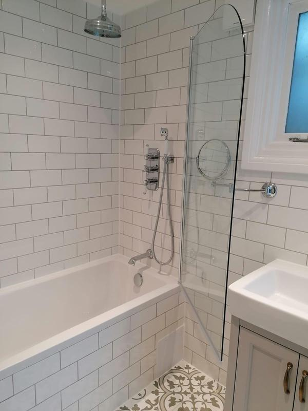 Image 3 - RELM completed a bathroom revamp in Putney. This bathroom was stripped down, given a fresh paint, new flooring, new tiling, plumbing and new fixtures and fittings installed.