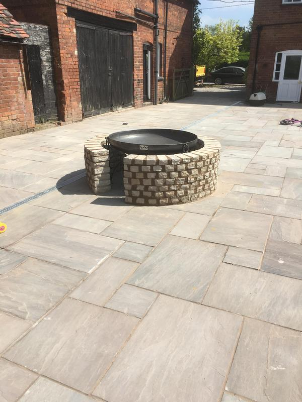 Image 200 - Freestanding fire pit with Raj blend natural stone walling surround