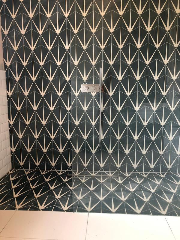 Image 1 - Fully designed and installed tile patterned walk in shower with white marble effect floor tiles.