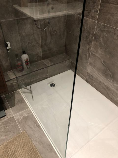 Image 11 - Low level walk in shower and full height glass panel. Includes matching existing tiles.