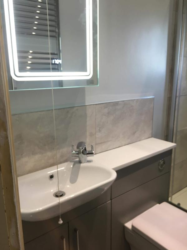 Image 32 - Mirror and sinks in place