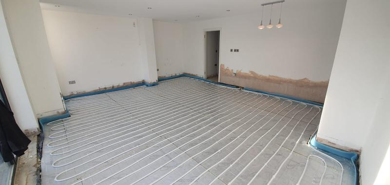 Image 8 - Underfloor heating system in a lounge area controlled by its own thermostat.