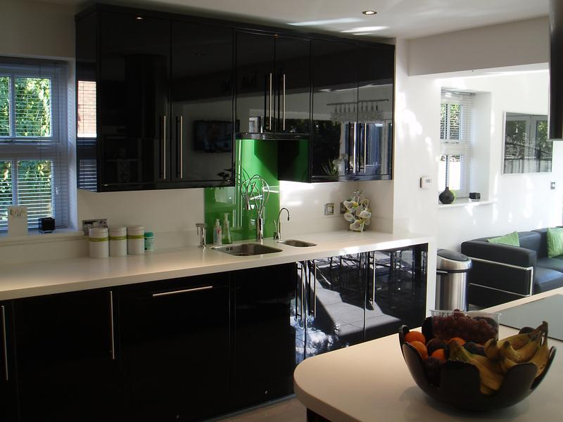 Image 5 - Black gloss units and white work tops