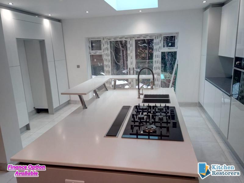 Image 21 - Modern Full Kitchen Fitted in an Extension, True Handle-less UnitsDoor Colour: Acrylic High Gloss White with High Gloss Light Grey Panels/PlinthsWorktop Colour: Solid Surface Worktops (Glacier Island and Zenith)
