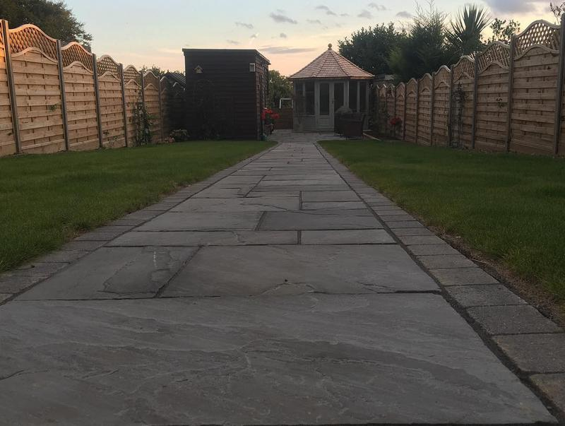 Image 50 - Indian Sandstone Paving in Grey, turf and fencing