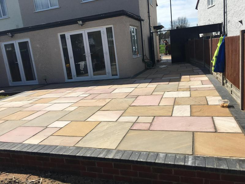 Image 9 - New Indian sandstone patio with charcoal brick border and charcoal pointing
