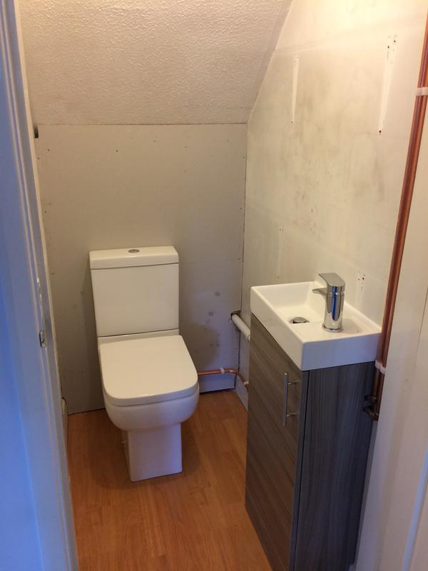 Image 53 - A cloakroom fitted under the stairs
