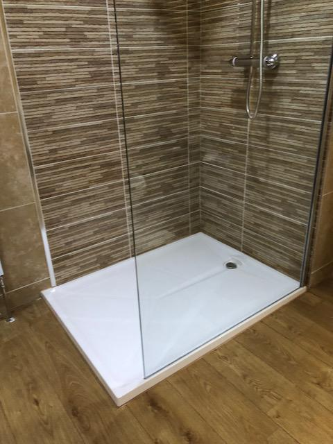 Image 5 - Low level walk in tray (40mm) full height glass panel, thermostatic mixer shower and contrast tiling in shower area.