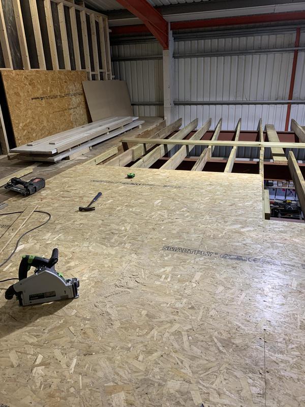 Image 28 - Installation of mezzanine floor.
