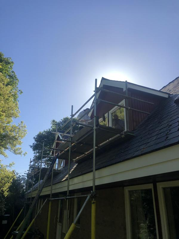 Image 3 - Work being done on Dorma windows. Back side of the property.