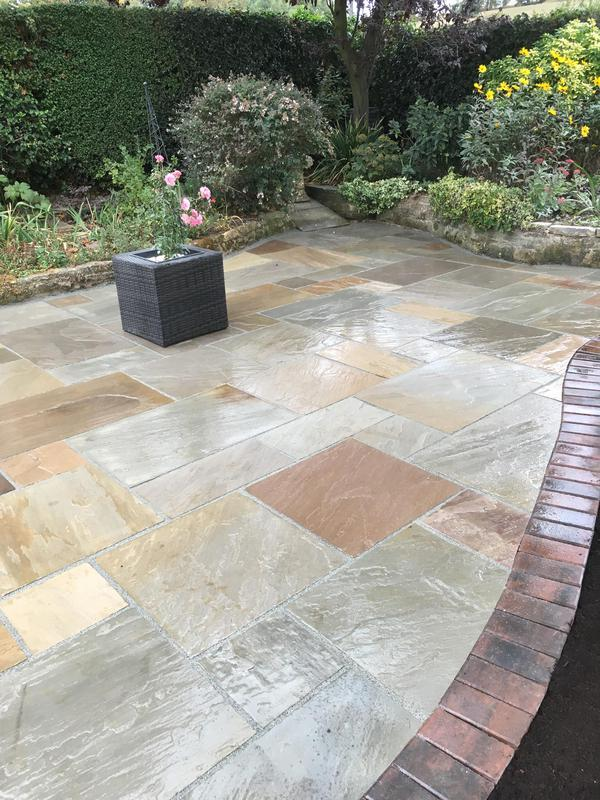 Image 33 - Indian sandstone paving with block paving border