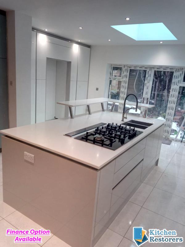 Image 22 - Modern Full Kitchen Fitted in an Extension, True Handle-less UnitsDoor Colour: Acrylic High Gloss White with High Gloss Light Grey Panels/PlinthsWorktop Colour: Solid Surface Worktops (Glacier Island and Zenith)