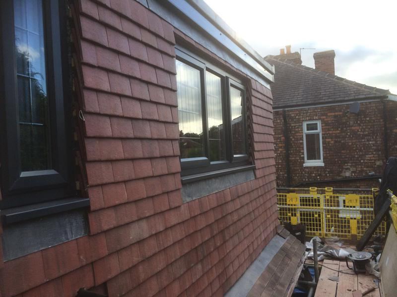 Image 3 - Dormer conversation tiled with old English small tiles with new lead work.