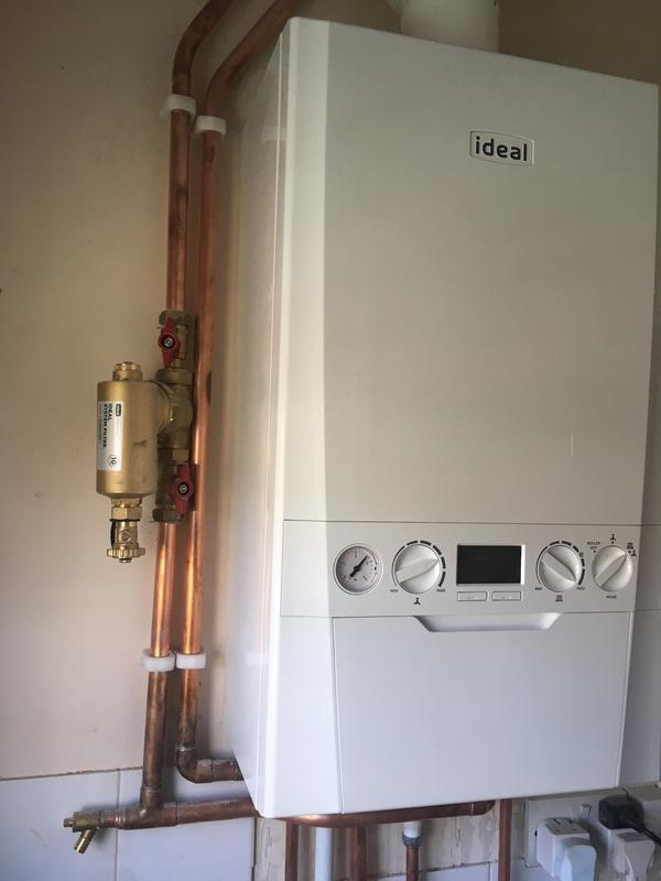 Image 49 - Old boiler and cylinder out and a new combi boiler installation