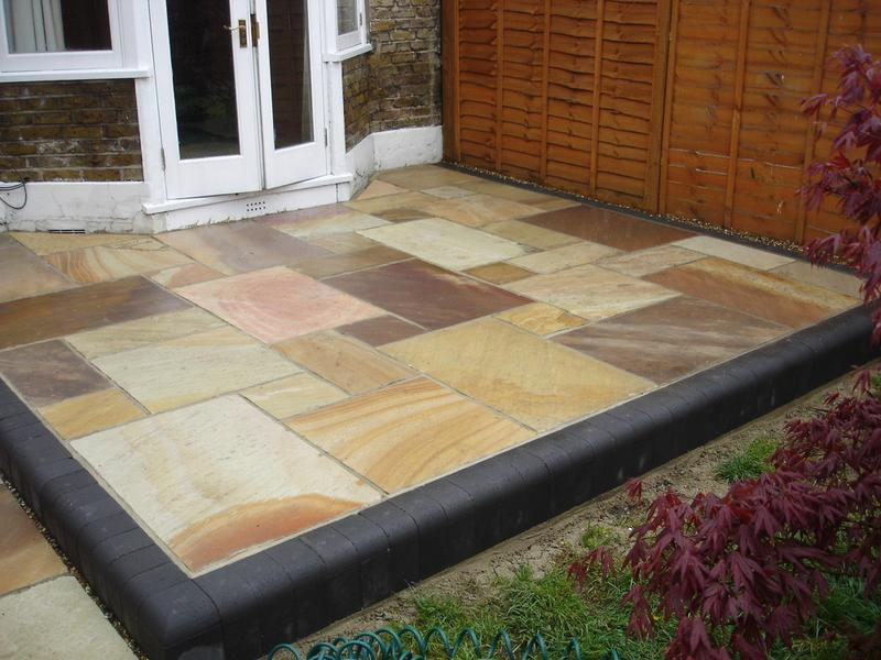 Image 19 - To lay grey edgeing paviors and multi colour indian stone  and point up to seal in canterbury