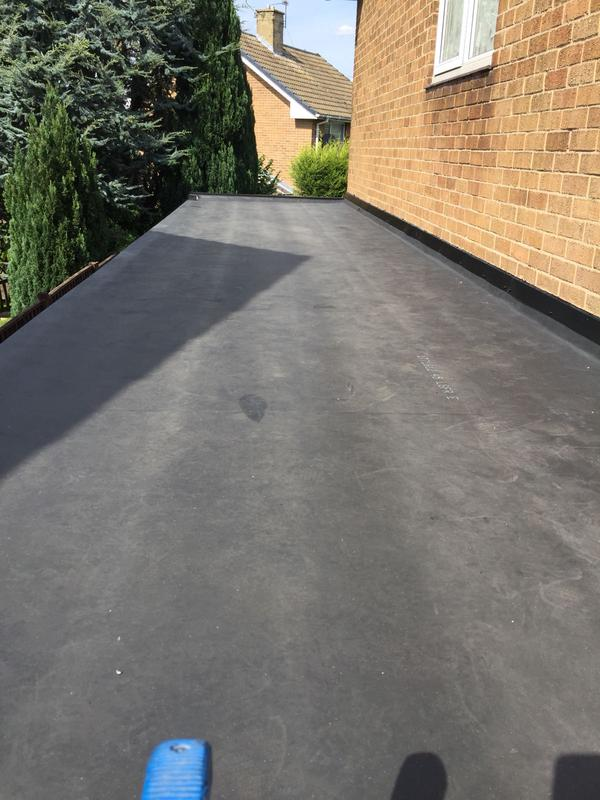 Image 6 - Typical wear and tear of felt roof after 20 years sagging in places broken and split ends coursing leakes and dampness ready to be renewed with firestone rubber 20yrs garrentee
