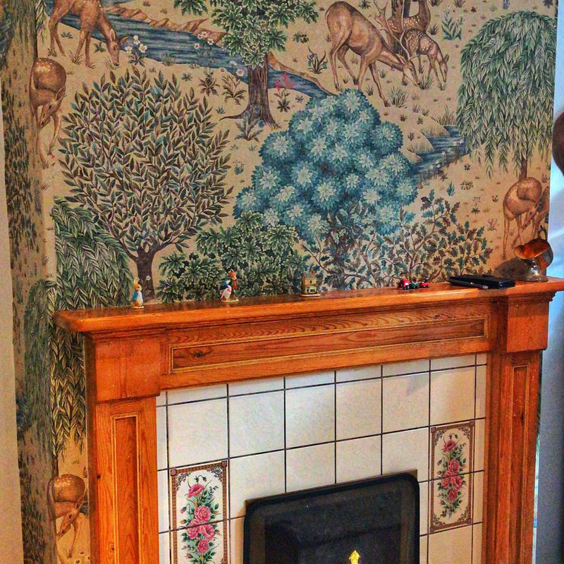Image 1 - wallpapered mural on chimney breast for a job in Ely completed on the 22nd /10/19