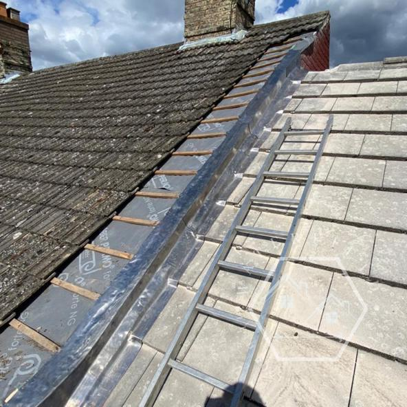 Image 16 - New felt and batten with lead flashings