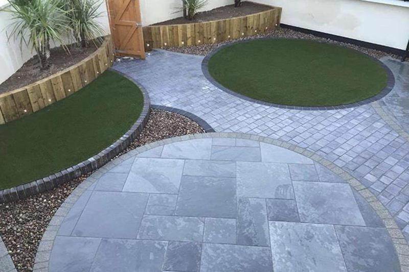 Image 29 - circle project- artifical grass, paving, block paving, flower beds