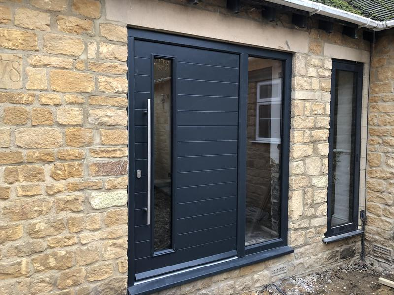 Image 14 - Engineered timber door and aluminium window to the side