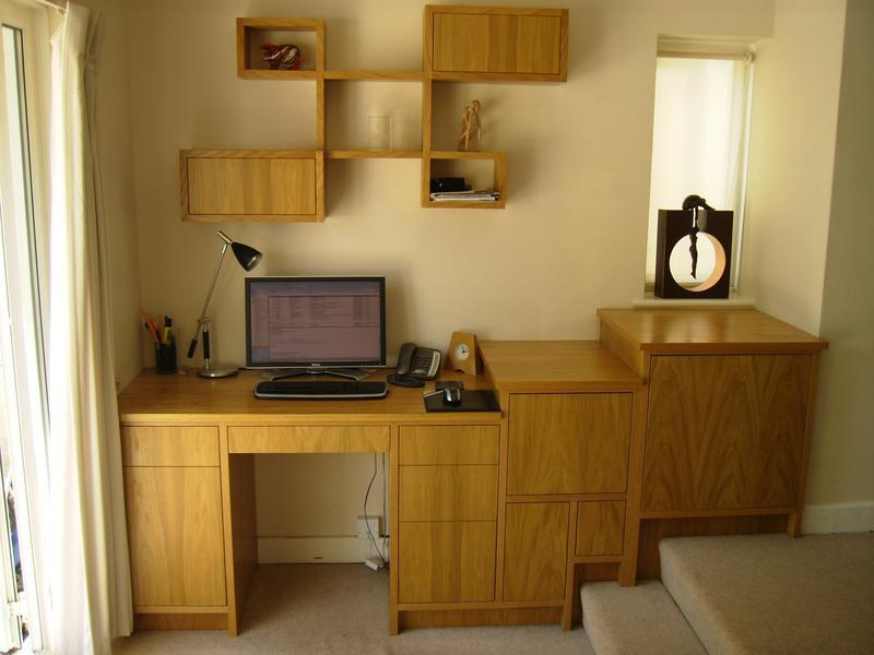 Image 52 - Awkward area desk . With stepped cabinets with staggered wall shelving .