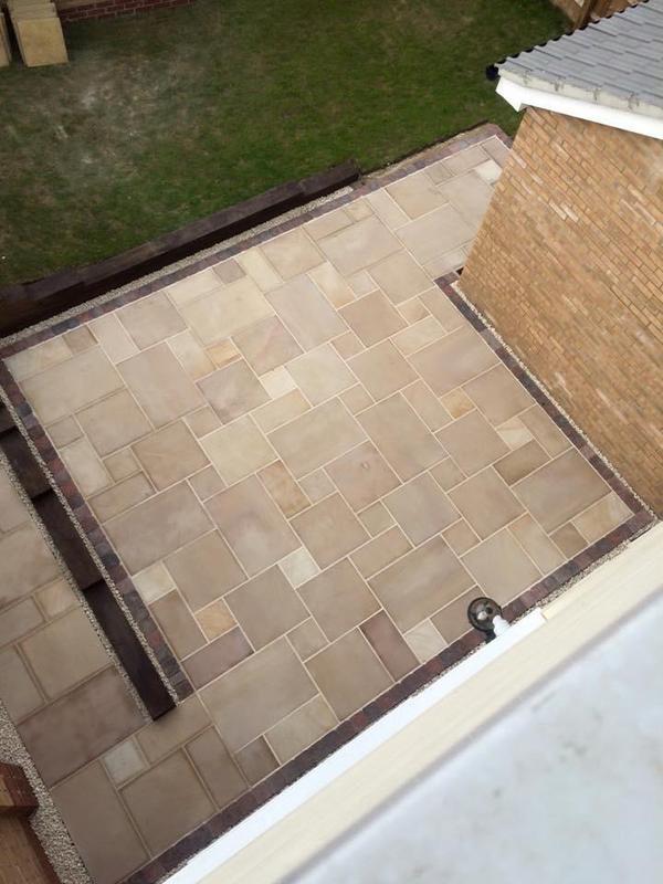 Image 203 - Nice smooth sandstone patio with sleeper retaining wall.