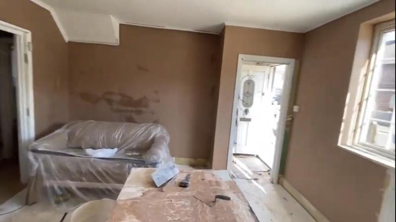 Image 7 - Plastered living room.