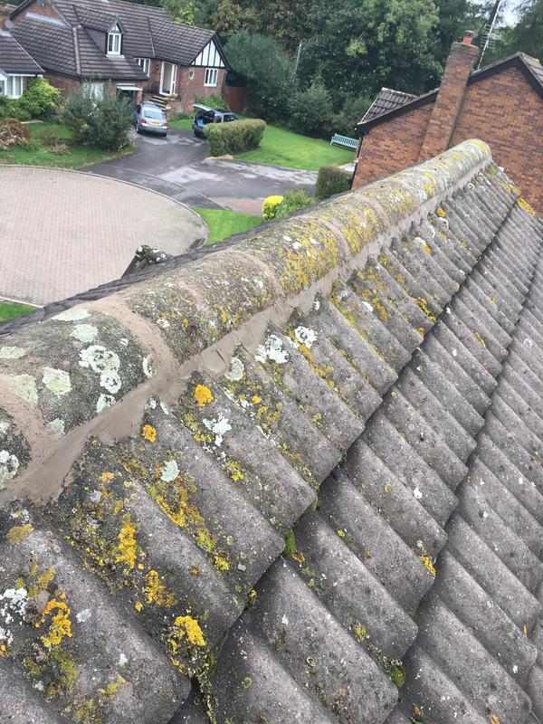 Image 100 - Ridge tiles re-bedded and repointed